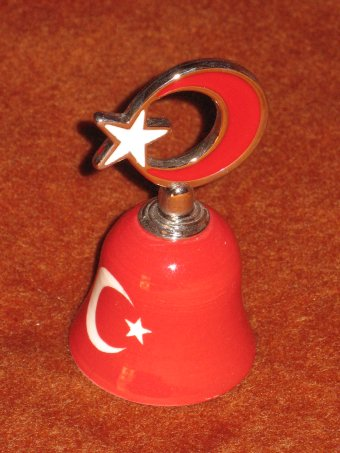 a clay bell from Turkey, wonderfull colour and design.