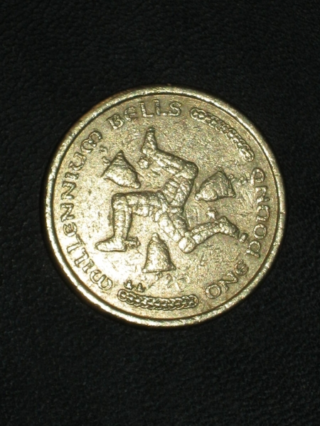 An one pound coin from the Isle of Man featuring a portrait of Elizabeth II on one side and the Manx triskelion with millennium bells on the other