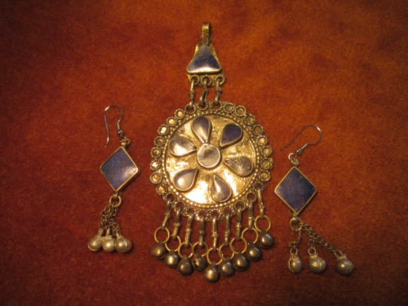 The pandant is very old (14,th century) and is made in bronze with blue lapis insertions